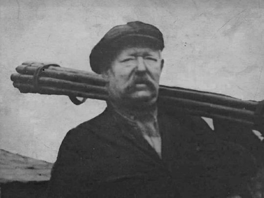 An old picture of a chimney sweep